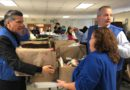 Catholic Charities and archbishop distribute Thanksgiving turkey boxes